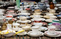 decorated coffee mugs made of fine china porcelain, also called collectors' cups, for sale at a flea market, selected focus, narrow depth of field